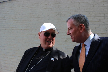 The Archdiocese of New York will contribute 150 spaces to a $12 million effort to provide 500 beds for the homeless at faith-based organizations, Mayor Bill de Blasio and Cardinal Timothy Dolan announced on the eve of Pope Francis' visit to the city.