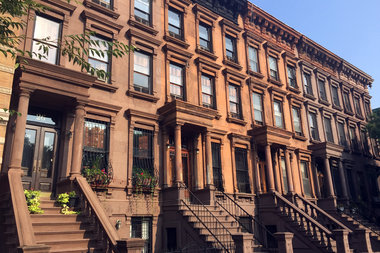 A woman posed as a landlord in an undisclosed Harlem brownstone and collected more than $190,000 in rent from tenants, officials said.