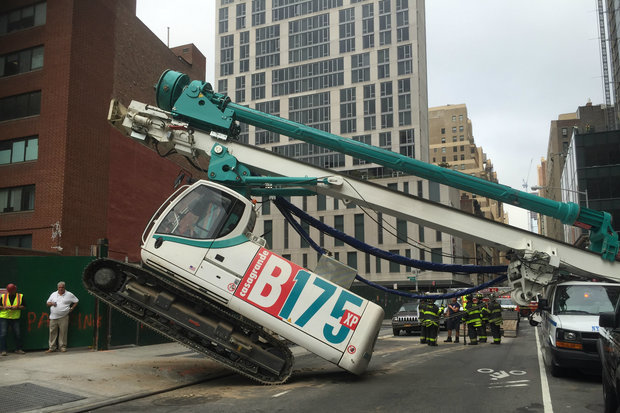 Huge Construction Drill Tips Over and Crushes NYPD Van in Midtown
