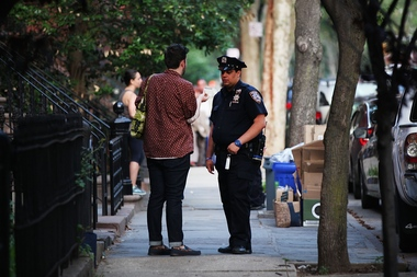 An NYPD officer talks to a man in Brooklyn in June 2015. On Oct. 3, the activist group Police Reform Organizing Project will hand out mock summonses to white people in Park Slope to highlight racial disparities in policing, they say.