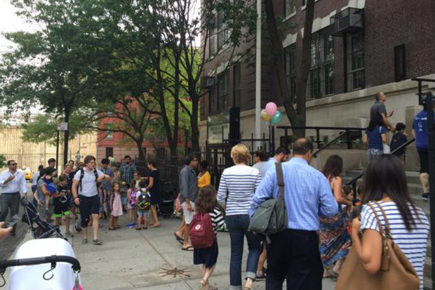 Kids and parents outside P.S. 8 in Brooklyn Heights on the first day of school on Sept. 9, 2015.