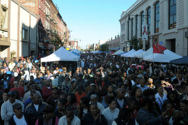 Attendees of Restoration Rocks gather along Fulton Street at 2013's Bed-Stuy Alive! celebration. This year, Fantastic Negrito, Ryan Davis Harris, and DJ Reborn will be part of the music festival on Oct. 8.