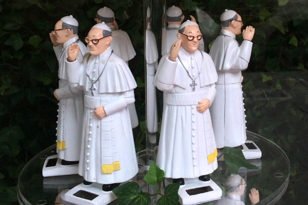 Street vendors have been capitalizing on Pope Francis' visit, selling papal swag around the city.