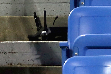 A city teacher was arrested after crashing a drone into the stands at Louis Armstrong Stadium during an U.S. Open match on Sept. 3, 2015, police said.