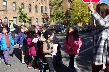 Children from P.S. 343 cross 47th Avenue at 42nd Street in Sunnyside on Oct. 19, 2015, during a rally to call for a traffic light at the intersection.