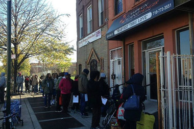 Dozens of people line up for the pantry at Bed-Stuy Campaign Against Hunger. The organization is looking for volunteers on Thanksgiving week to assist with loading and unloading food and giving out turkeys.