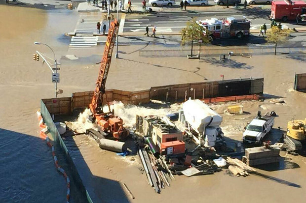 The water main broke at a construction site at 51-35 Reeder St., officials said.