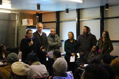 Members of the group Friends of Bushwick Inlet Park urged attendees to vote against the East New York rezoning plan, citing