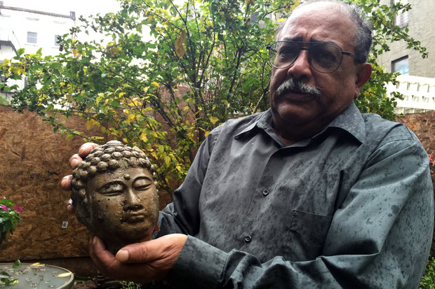 A disgruntled neighbor placed a curse on a construction site after a statue of Buddha that protected his garden was decapitated.