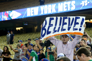 A New York Mets fan holds up a sign after the Mets 3-2 victory against the Los Angeles Dodgers in game five of the National League Division Series at Dodger Stadium on October 15, 2015 in Los Angeles, Calif.