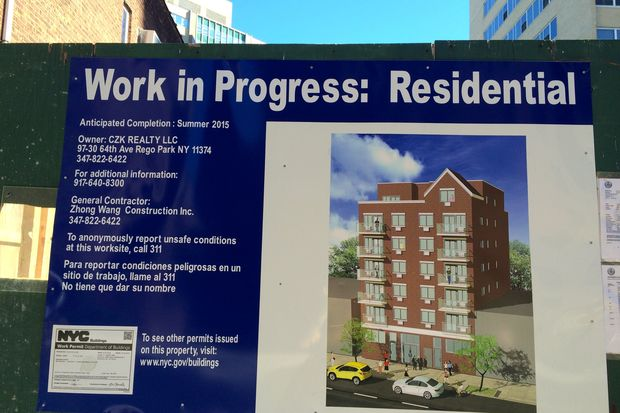A 7-story building is currently under construction at 97-30 64th Ave.