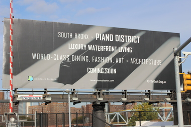 Bronxites concerned about gentrification have responded to the Piano District billboard with the social media campaign #WhatPianoDistrict.