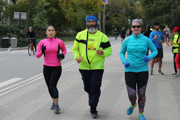 DNAinfo/Nicole Levy — Pierre runs in between his guides, Rebecca Noriega, left, and Valerie Kenney, right