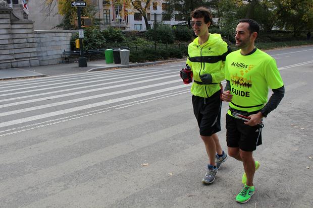 DNAinfo/Nicole Levy — Catherine, left, runs alongside his guide, Matt Liebman.