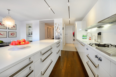 "This Upper East Side ""classic 7"" 3-bedroom at 30 E. 65th St., listed for $4.395 million, has a custom-designed mudroom in the entryway on the other side of this kitchen, which is in the foreground."