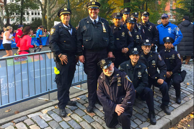 Roger Thomas (back row, second from left), commanding officer of the Central Park Precinct's Auxiliary unit, has ramped up recruitment of volunteers for the volunteer police unit.