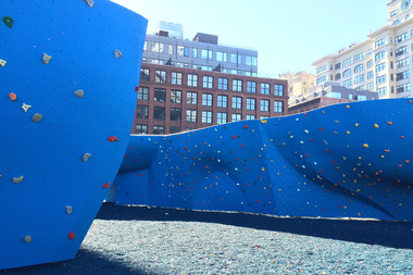 DUMBO Boulders reopened after a several-day closure caused when a hunk of metal fell from the Manhattan Bridge tracks nearly striking climbers in the outdoor climbing gym below.