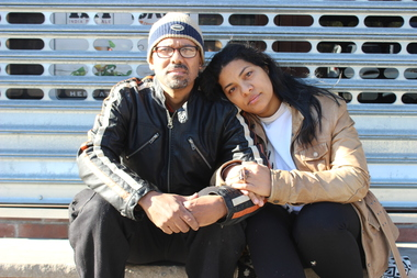 Wascar Santos and Eva Diaz sit outside of their restaurant Calientito shortly after being evicted.
