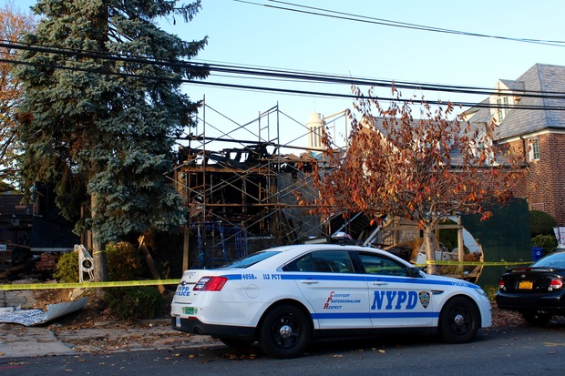 Police are monitoring the area at 108-47 67th Dr. where a two-story home was destroyed on Nov. 25.