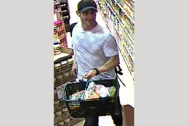 Police released a surveillance photo of a suspect shopping at KeyFood after he stole a wallet from the men's locker at a Kew Gardens gym.