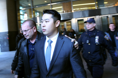 Peter Liang is escorted out of court in Brooklyn after being charged with manslaughter, official misconduct and other offenses on Feb. 11, 2015.