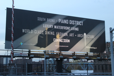 Three splotches of paint have appeared running down the center of the controversial Piano District billboard.