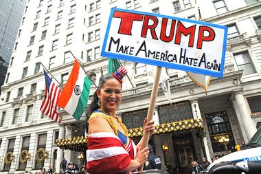 Protester Marni Halasa stands outside the Plaza Hotel to protest Donald Trump, who was speaking inside the hotel. Many anti-Trump events are planned in New York as he is sworn in on Friday in Washington.