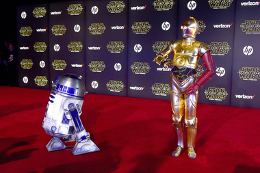 C-3PO, seen here with his good pal R2-D2, was originally supposed to speak like a used car dealer from The Bronx.