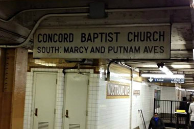 The original sign for Concord Baptist Church of Christ went missing from the Nostrand Avenue A/C train station platform in early November, according to church leaders.