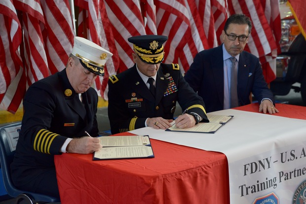 Chief of Department James Leonard, Maj. Gen. Anthony Funkhouser and Commissioner Daniel Nigro signed a partnership agreement on Dec. 8 between the United States Army and the FDNY.