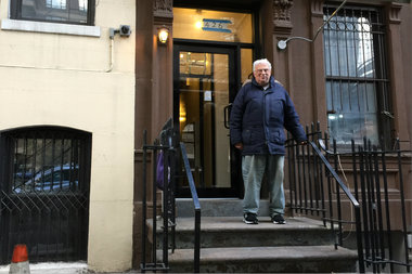 Charles Fernandez stands outside the building in which he has lived since 1959. He fears the demolition of a neighboring building could damage his home and force him out off the block of East 58th Street where he has lived his entire life.