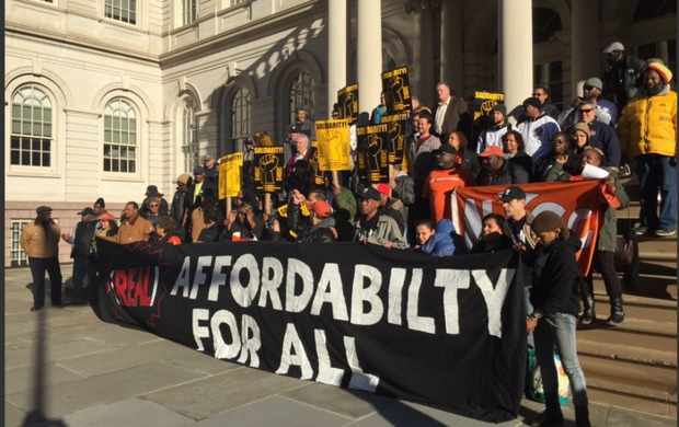 Housing activists protested Mayor Bill de Blasio's affordable housing rezoning plan   in front of City Hall Tuesday, saying that it does not provide enough affordability for people who live in the affected neighborhoods and that the city refuses to use their leverage to force developers to hire union workers.