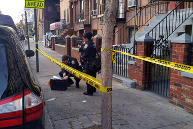 Police officers respond to a Thanksgiving day shooting on East 115th Street and Third Avenue.