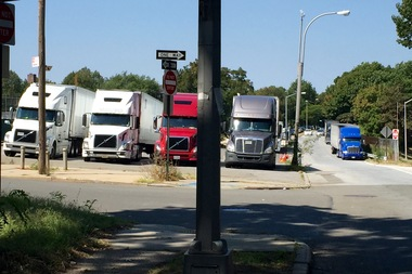 Residents have voiced concerns about tractor trailers parked in a parking lot behind Forest Hills High School and along the Grand Central Parkways service road.
