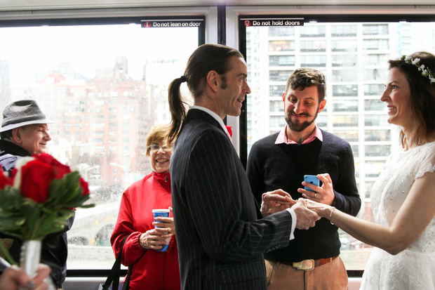 Wes and Jennifer Hansen were married high above the East River on Dec. 22 during a lightning-fast ceremony inside the Roosevelt Island Tram. The ride only takes 4 minutes total.