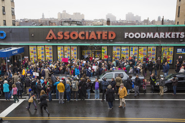 Hundreds of protesters stood in the rain last year to rally in support of an Associated Supermarket in Washington Heights.