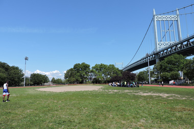 The Parks Department will build a soccer field in the center of the running track at Astoria Park.