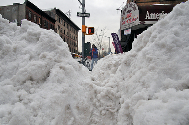 Pedestrians had to navigate huge piles of snow on street corners Monday after the weekend's historic blizzard. Corner property owners or renters were responsible for clearing a path.
