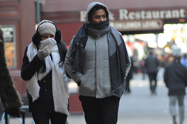 A couple walk through Midtown during a cold, mid-winter day, Jan. 21, 2016.