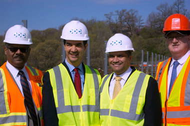 Councilman Ydanis Rodriguez (center left) and Department of Design and Construction Commissioner Feniosky Pena-Mora (center right) pose in May 2014 at the High Bridge, which was undergoing renovation. Pena-Mora hired Rodriguez's wife to be a special assistant to the commissioner at the DDC in June 2014.