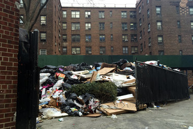 This trash pile on 102nd Street hasn't been cleared in months, according to residents of the East River Houses.