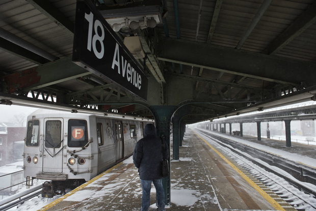 Subway service has resumed following delays caused by snow and a crane collapse.