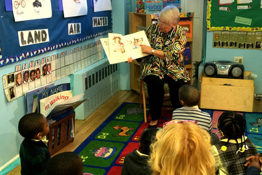 Schools Chancellor Carmen Farina reads to pre-k students at Bed-Stuy's Bambi Day Care Center on Monday, when applications for pre-k programs opened throughout the city.