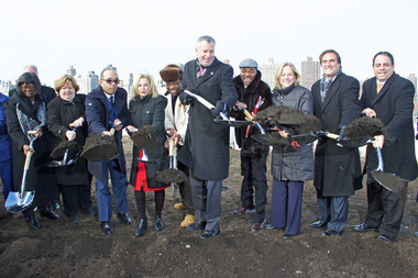 Mayor Bill de Blasio and other officials celebrate the groundbreaking of the Hallets Point project in Astoria on Jan. 14, 2016.