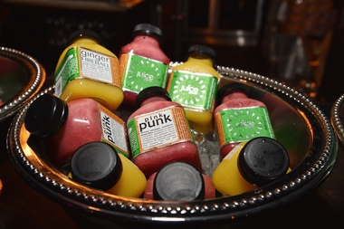 A collection of Juice Press products at a 2014 event