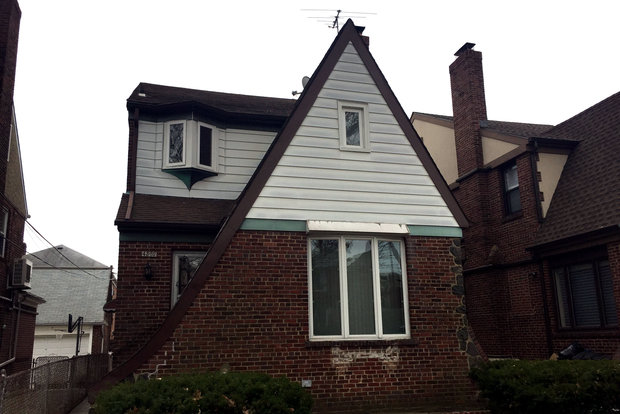 Sook Yeong Park allegedly brought a 9-year-old boy and an 11-year-old girl to the U.S. in 2010. She kept them in this home in Flushing, the DA said.