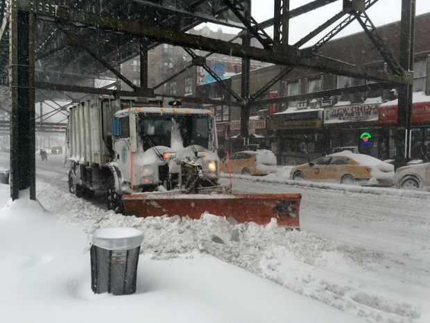 A Department of Sanitation snowplow on Roosevelt Avenue in Woodside, Queens during the Jan. 23, 2016 blizzard. The storm is projected to be one of the worst in the city's history.