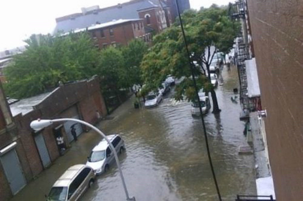 Flooding on Carroll Street off Fourth Avenue in Gowanus. The city will soon start work on installing new sewer lines for stormwater that will help reduce flooding, officials say.