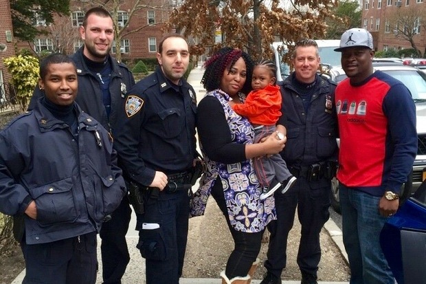 Forest Hills police officers helped rescue a 9-month-old girl who got trapped in a car.