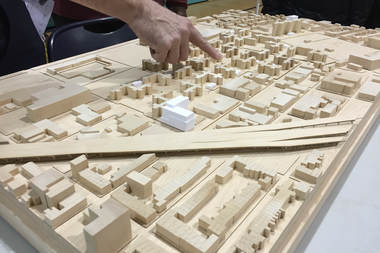 A 3-D model of the Red Hook East and West Houses campus displayed during a meeting in February 2016. The white block show the proposed locations of the power plant and utility pods.
